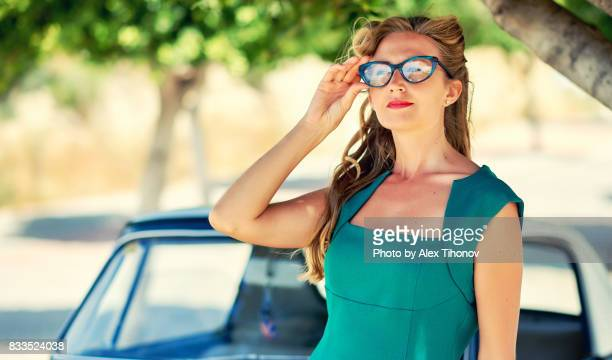 woman outdoors - green dress stock pictures, royalty-free photos & images