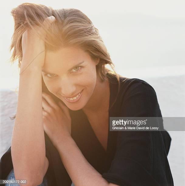 Woman outdoors, smiling, portrait, close-up