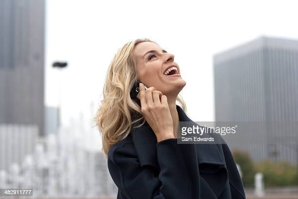 woman outdoors using cellular phone - overexposed stock photos and pictures