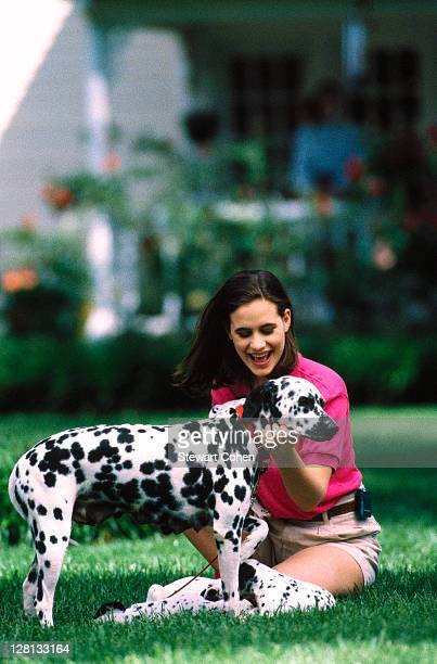 Woman outdoors w/ dog and puppies