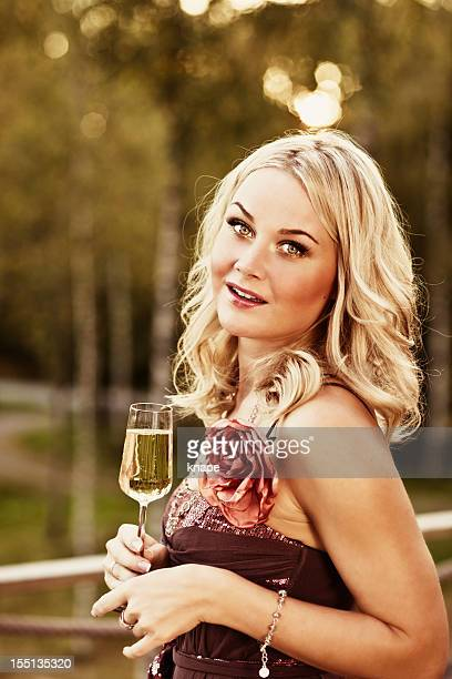Woman outdoors with champagne