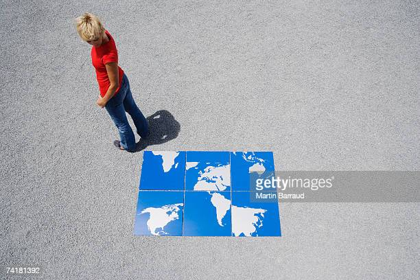 Woman outdoors with world map puzzle