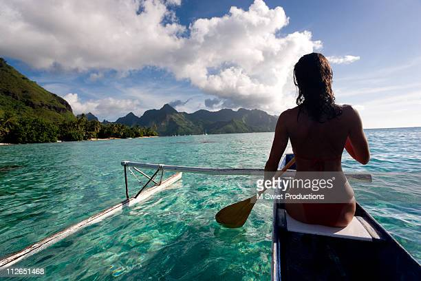 woman outrigger paddle canoe - tahiti stock pictures, royalty-free photos & images