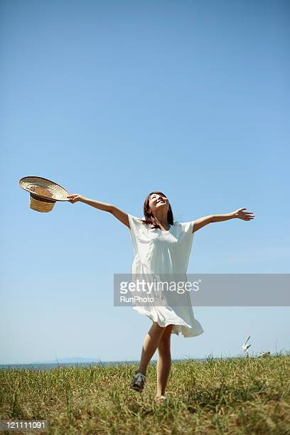 woman outstretched hands on the grass