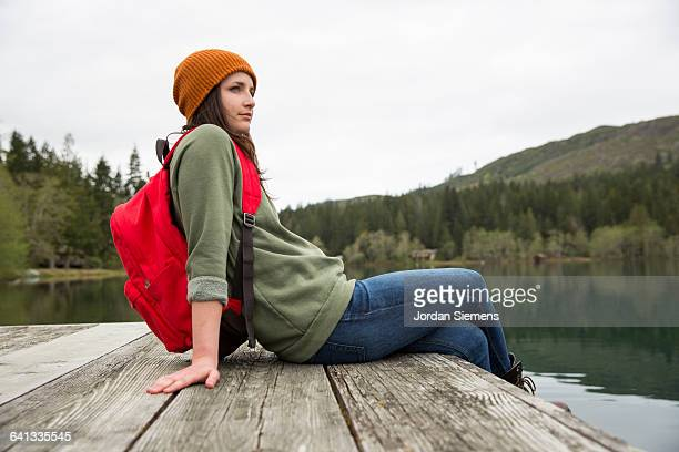 A woman overlooking a lake.