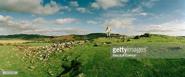 woman overlooking capital of dalriada - everton women stock pictures, royalty-free photos & images