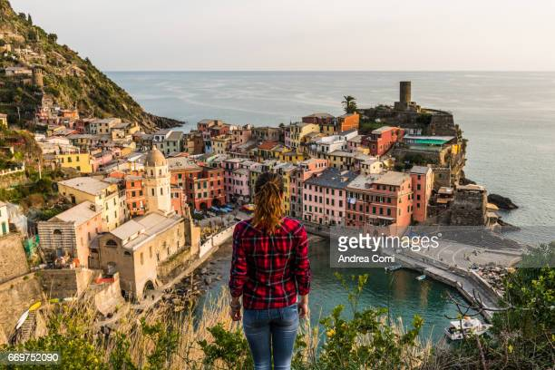 A woman overlooking on Vernazza from the lookout. Cinque Terre, La spezia, Liguria