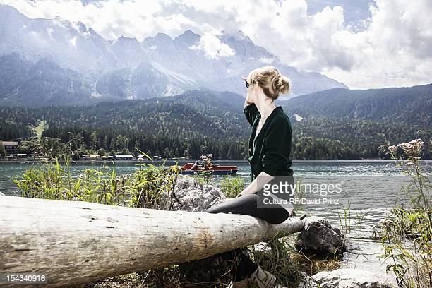 Woman overlooking rural lake