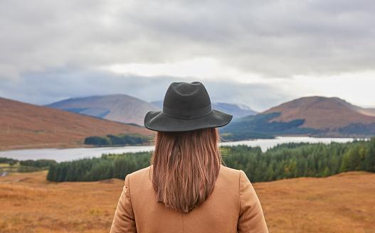 Woman overlooking Scottish landscape - gettyimageskorea