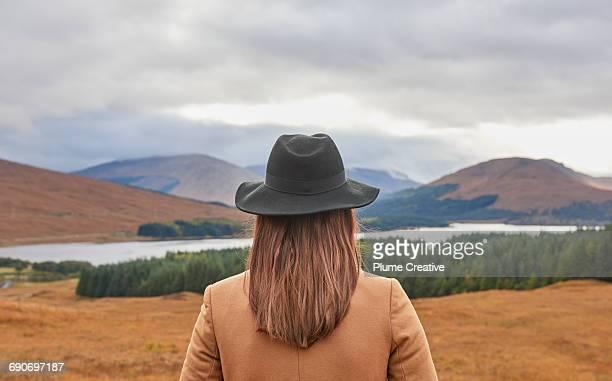 Woman overlooking Scottish landscape