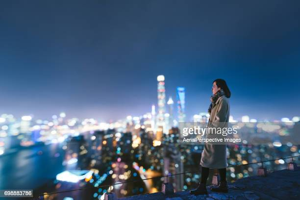 woman overlooking the stunning city of shanghai - the bigger picture stock pictures, royalty-free photos & images