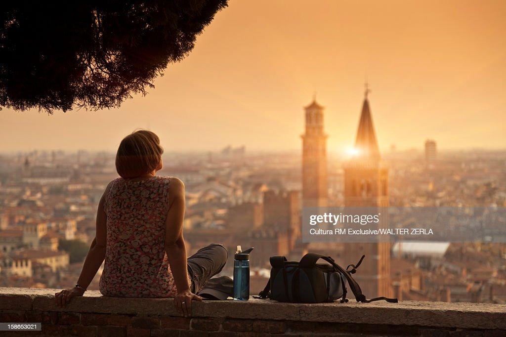 Woman overlooking urban cityscape : Stock Photo