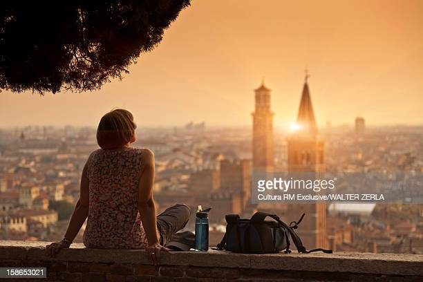 Woman overlooking urban cityscape