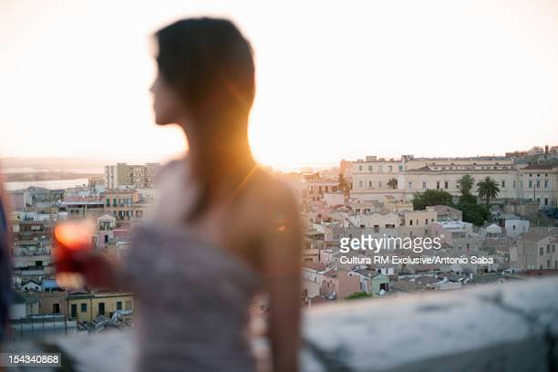 Woman overlooking view from balcony