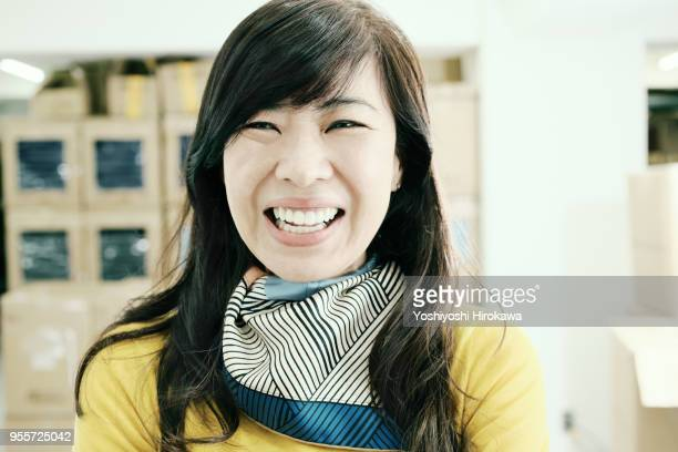 Woman owner work on new products with smile