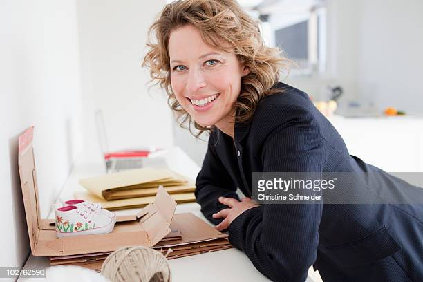 Woman packing baby shoes