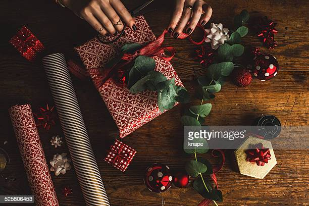 Woman packing contemporary christmas gifts