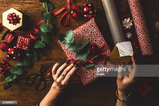 woman packing contemporary christmas gifts - gift box stock pictures, royalty-free photos & images