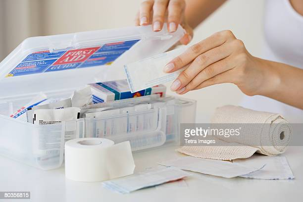 Woman packing first aid kit
