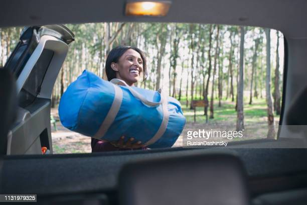 woman packing for camping trip. - city break stock pictures, royalty-free photos & images