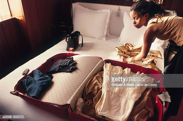 woman packing suitcase - endopack stock pictures, royalty-free photos & images