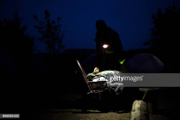 Woman packs up her backpack quotCamp for Forestquot Pogorzelce near Bialowieza on September 21 2017