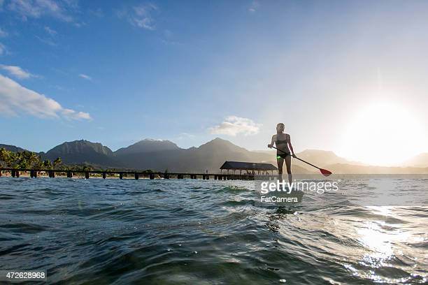 Woman Paddle Boarding in the Sun