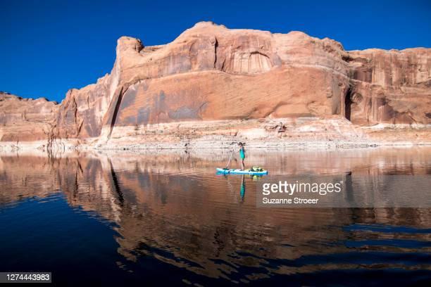 woman paddle boarding, lake powell, utah, usa - utah stock pictures, royalty-free photos & images