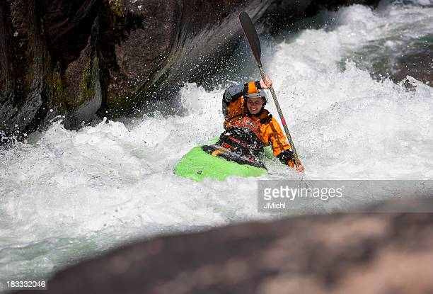Woman Paddling a White Water Kayak on a Montana River