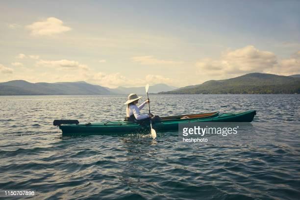 woman paddling kayak, adirondacks, lake george, new york, united states - heshphoto ストックフォトと画像