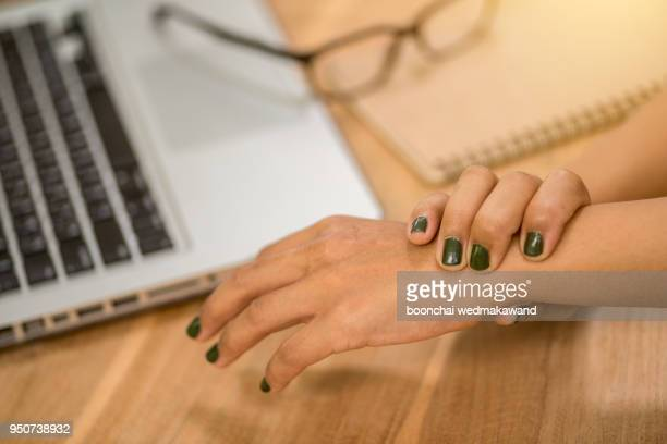 woman painful finger due to prolonged use of keyboard and mouse. - spinal cord injury stock photos and pictures