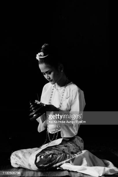 woman painting against black background - ko ko htike aung stock pictures, royalty-free photos & images