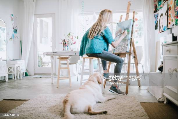 Woman Painting at Home Art Studio
