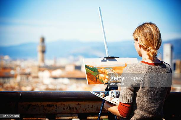 Woman painting beautiful view on Piazzale Michelangelo, Firenze,