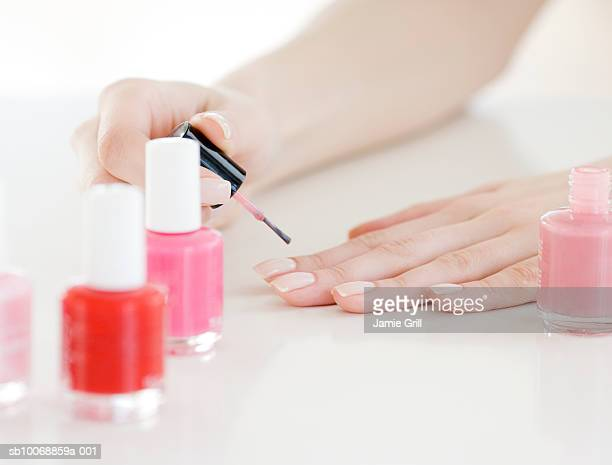 Woman painting nails, close-up