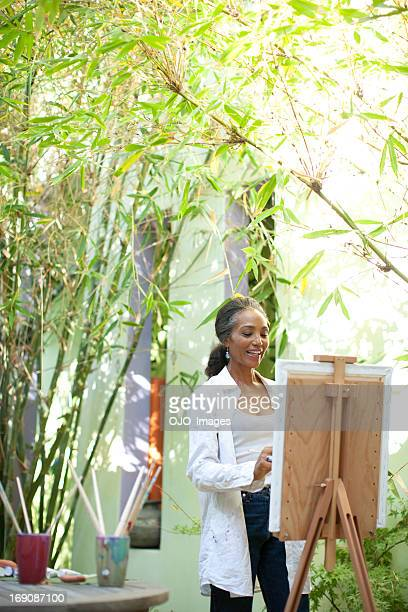 Woman painting on patio