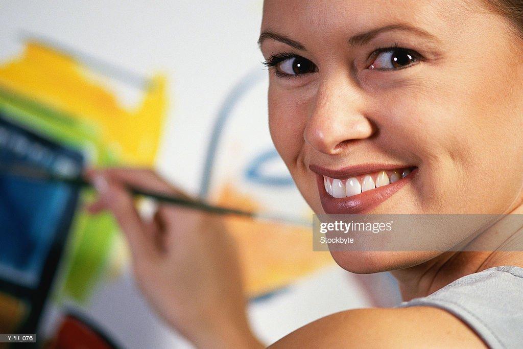 Woman painting : Stock Photo