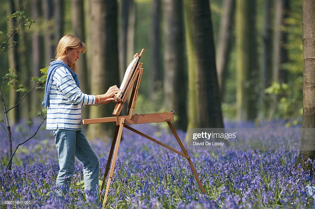 Woman painting, side view : Stock Photo
