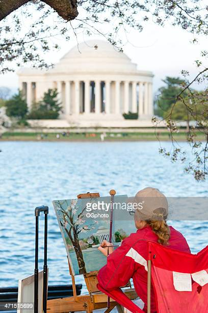 woman painting the jefferson memorial - ogphoto stock photos and pictures