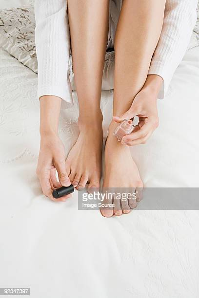 Woman painting toenails