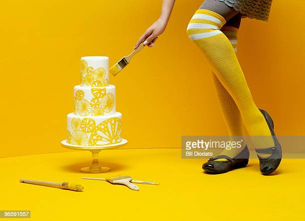 Woman painting wedding cake