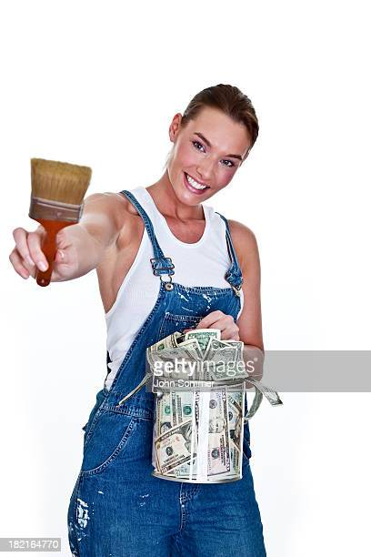 Woman painting with can of money