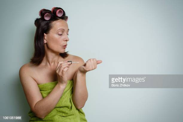 woman paints her nails. - human head stock pictures, royalty-free photos & images