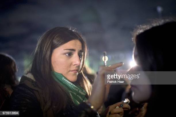 A woman paints the face of another during a rally to demand legal and free abortion at Congressional Plaza on June 13 2018 in Buenos Aires Argentina...