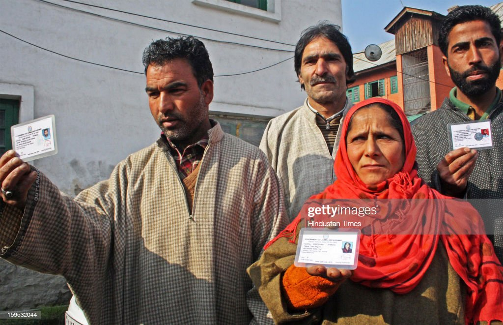 A woman Panch Sara Begum from Duroo Sopore along with other panchs showing identity cards resigned before media on January 15, 2013 in Srinagar, India. Some 54 Sarpanchs and Panchs resigned in four days in North Kashmir after Militants killed one Sarpanch and injured other female Panch in recent attacks in North Kashmir Sopore town.