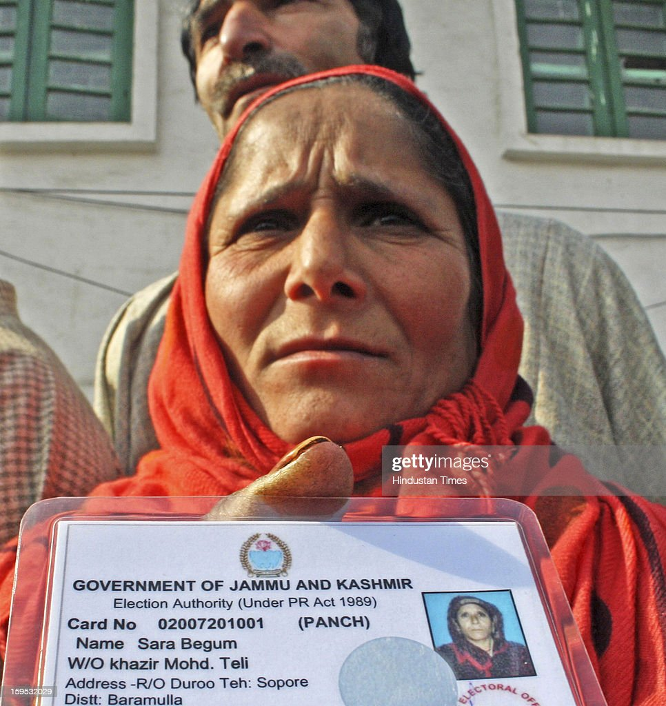 A woman Panch Sara Begum from Duroo Sopore showing identity card resigned with other panchs before media on January 15, 2013 in Srinagar, India. Some 54 Sarpanchs and Panchs resigned in four days in North Kashmir after Militants killed one Sarpanch and injured other female Panch in recent attacks in North Kashmir Sopore town.
