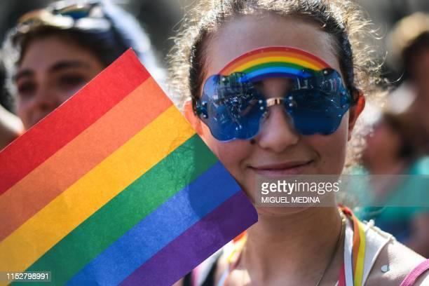 Woman parades during the Milan Pride 2019 on June 29, 2019 in Milan, as part of the LGBT Pride month marking the 50th anniversary of the New York...