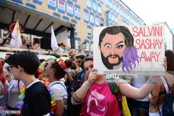 A woman parades with a sign showing Italy's Interior Minister during the Milan Pride 2019 on June 29 2019 in Milan as part of the LGBT Pride month...