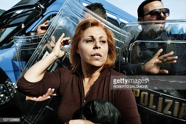 A woman paricipates in a demonstration near riot police in Terzigno on October 18 2010 during a protest against the opening of a new garbage site on...