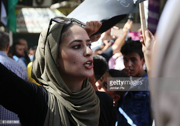 Woman participates during a protest by activivists from the coalition of leftist and nationalist parties in Jordan against the gas deal with Israel...